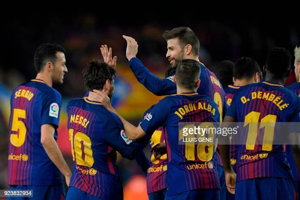 Barcelona's Argentinian forward Lionel Messi celebrates with teammates Barcelona's Spanish midfielder Sergio Busquets Barcelona's Spanish defender...