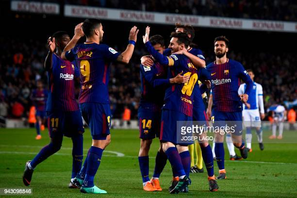 Barcelona's Argentinian forward Lionel Messi celebrates with teammates after scoring a goal during the Spanish league football match between...