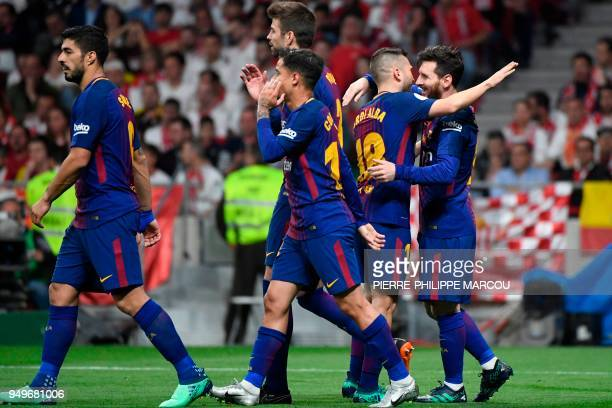 Barcelona's Argentinian forward Lionel Messi celebrates with teammates after scoring during the Spanish Copa del Rey final football match Sevilla FC...