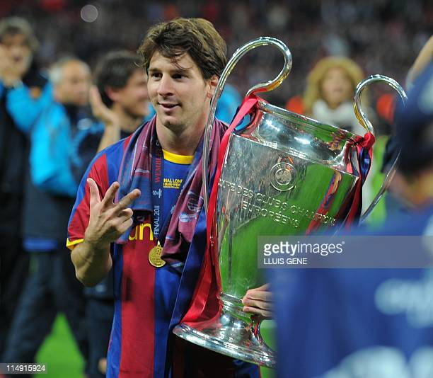 Barcelona's Argentinian forward Lionel Messi celebrates with the trophy at the end of the UEFA Champions League final football match FC Barcelona vs...