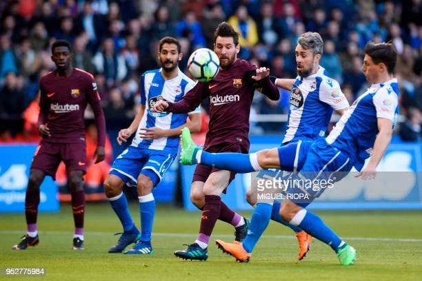 TOPSHOT Barcelona's Argentinian forward Lionel Messi challenges Deportivo La Coruna's Portuguese defender Luisinho during the Spanish league football...