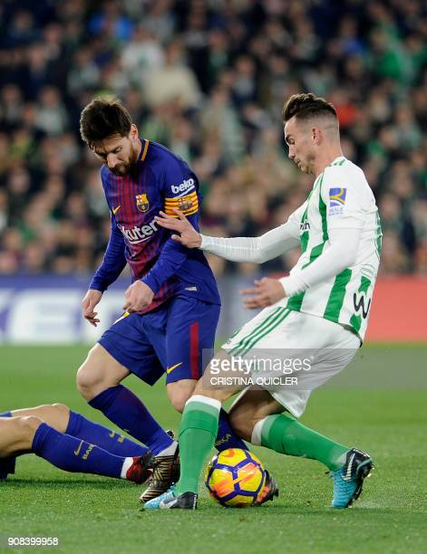 Barcelona's Argentinian forward Lionel Messi challenges Real Betis' Spanish midfielder Fabian Ruiz during the Spanish league football match between...