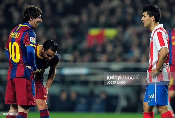 Barcelona's Argentinian forward Lionel Messi chats with Atletico Madrid's Argentinian forward Sergio Kun Aguero during the Spanish league football...