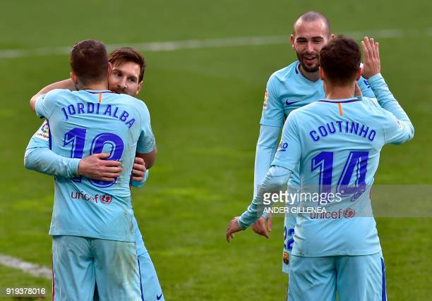 Barcelona's Argentinian forward Lionel Messi congratulates Barcelona's Spanish defender Jordi Alba for his goal while Barcelona's Brazilian...