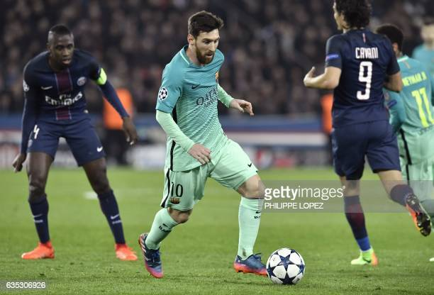 TOPSHOT Barcelona's Argentinian forward Lionel Messi controls the ball during the UEFA Champions League round of 16 first leg football match between...