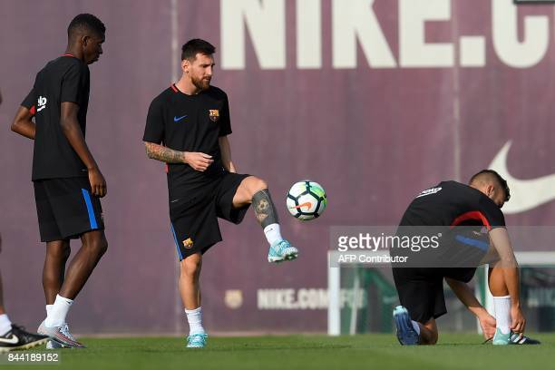 Barcelona's Argentinian forward Lionel Messi controls the ball during a training session at the Sports Center FC Barcelona Joan Gamper in Sant Joan...