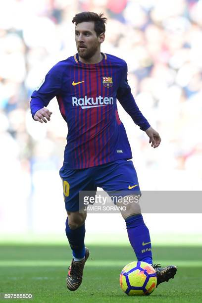 Barcelona's Argentinian forward Lionel Messi controls the ball during the Spanish League 'Clasico' football match Real Madrid CF vs FC Barcelona at...