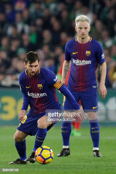 Barcelona's Argentinian forward Lionel Messi controls the ball during the Spanish league football match between Real Betis and FC Barcelona at the...
