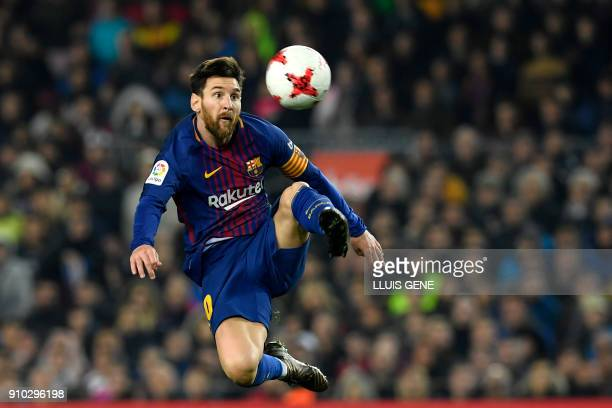 TOPSHOT Barcelona's Argentinian forward Lionel Messi controls the ball during the Spanish 'Copa del Rey' quarterfinal second leg football match...