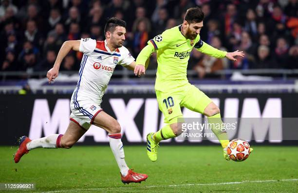 Barcelona's Argentinian forward Lionel Messi controls the ball next to Lyon's French defender Leo Dubois during the UEFA Champions League round of 16...