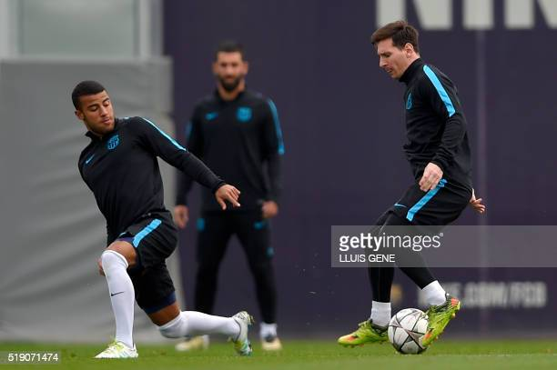 Barcelona's Argentinian forward Lionel Messi controls the ball past Barcelona's Brazilian midfielder Rafinha during a training session at the Sports...