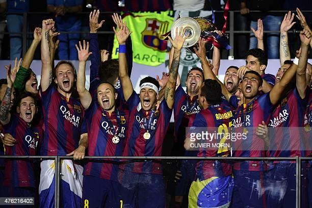 Barcelona's Argentinian forward Lionel Messi, Croatian midfielder Ivan Rakitic, midfielder Andres Iniesta, Brazilian forward Neymar da Silva Santos...