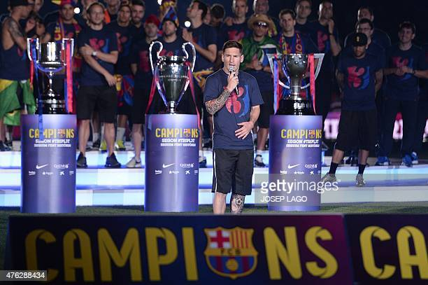 Barcelona's Argentinian forward Lionel Messi delivers a speech as he takes part in the celebrations held for their victory over Juventus, one day...
