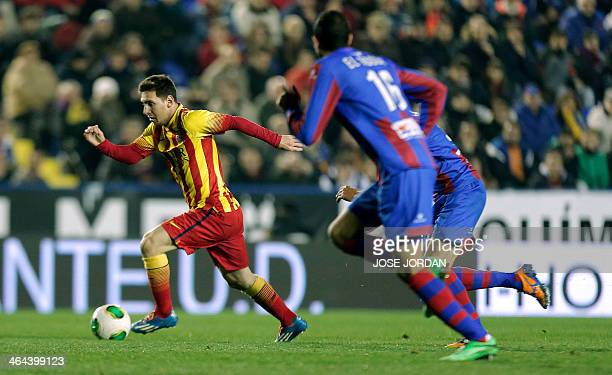 Barcelona's Argentinian forward Lionel Messi dribbles the ball during the Spanish Copa del Rey quarterfinal firstleg football match Levante UD vs FC...