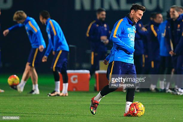 Barcelona's Argentinian forward Lionel Messi drives the ball during the first training session of the year at the Sports Center FC Barcelona Joan...