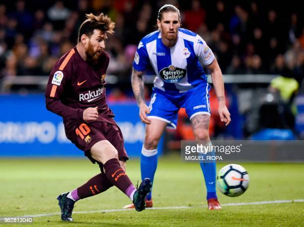 TOPSHOT Barcelona's Argentinian forward Lionel Messi during the Spanish league football match between Deportivo Coruna and FC Barcelona at the Riazor...