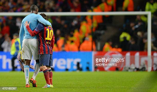 Barcelona's Argentinian forward Lionel Messi embraces Manchester City's Ivorian midfielder Yaya Toure after Barcelona won 20 during the UEFA...
