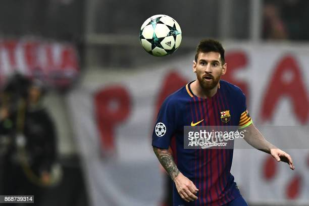 Barcelona's Argentinian forward Lionel Messi eyes the ball during the UEFA Champions League group D football match between FC Barcelona and...