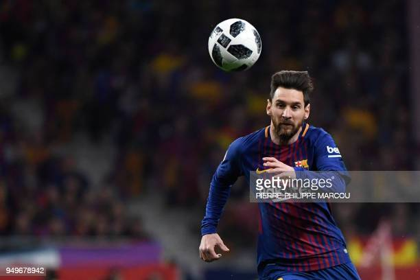 Barcelona's Argentinian forward Lionel Messi eyes the ball during the Spanish Copa del Rey final football match Sevilla FC against FC Barcelona at...