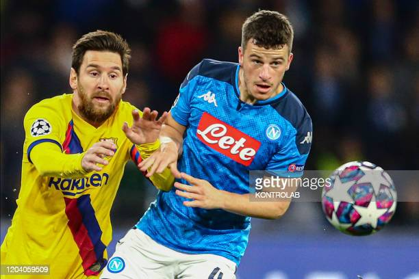 STADIUM NAPLES CAMPANIA ITALY Barcelona's Argentinian forward Lionel Messi fights for the ball with Napoli's German midfielder Diego Demme during the...