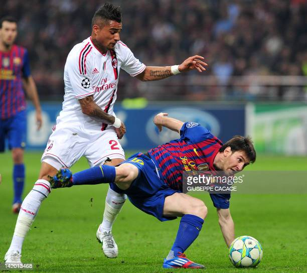 Barcelona's Argentinian forward Lionel Messi fights for the ball with AC Milan's Ghanaian defender Prince Kevin Boateng during the Champions League...