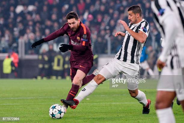 Barcelona's Argentinian forward Lionel Messi fights for the ball with Juventus' midfielder from Germany Sami Khedira during the UEFA Champions League...