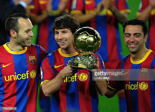 Barcelona's Argentinian forward Lionel Messi , flanked with Barcelona's midfielder Xavi Hernandez and Barcelona's midfielder Andres Iniesta , poses...