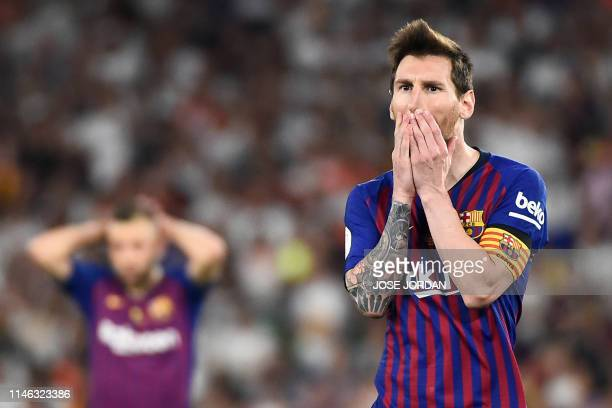 TOPSHOT Barcelona's Argentinian forward Lionel Messi gestures after shooting a free kick during the 2019 Spanish Copa del Rey final football match...