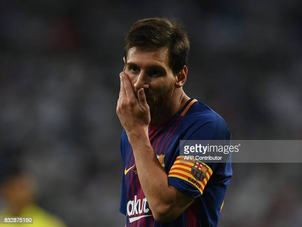 Barcelona's Argentinian forward Lionel Messi gestures during the second leg of the Spanish Supercup football match Real Madrid vs FC Barcelona at the...