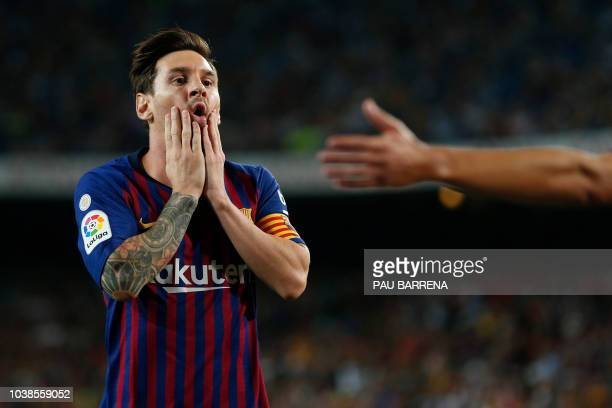 Barcelona's Argentinian forward Lionel Messi gestures during the Spanish league football match between FC Barcelona and Girona FC at the Camp Nou...