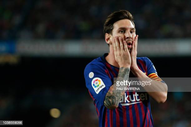 TOPSHOT Barcelona's Argentinian forward Lionel Messi gestures during the Spanish league football match between FC Barcelona and Girona FC at the Camp...