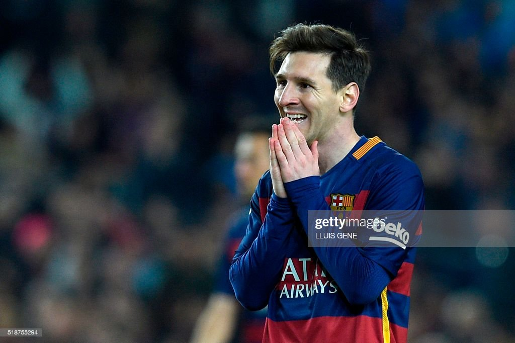 Barcelona's Argentinian forward Lionel Messi gestures during the Spanish league 'Clasico' football match FC Barcelona vs Real Madrid CF at the Camp Nou stadium in Barcelona on April 2, 2016. /