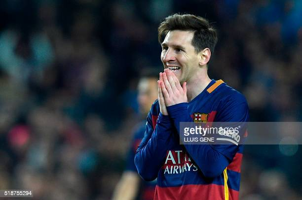 Barcelona's Argentinian forward Lionel Messi gestures during the Spanish league 'Clasico' football match FC Barcelona vs Real Madrid CF at the Camp...
