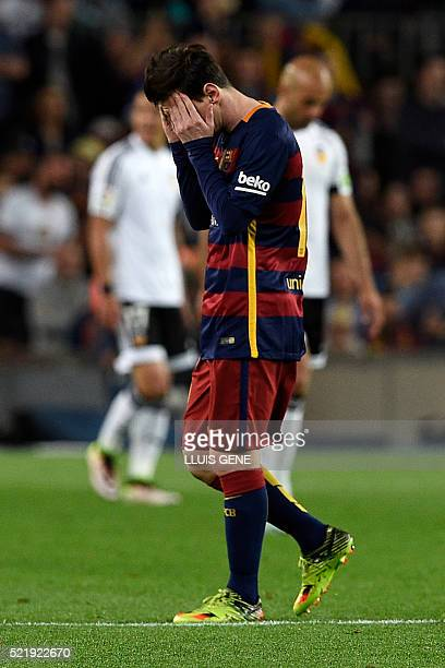 Barcelona's Argentinian forward Lionel Messi gestures during the Spanish league football match FC Barcelona vs Valencia CF at the Camp Nou stadium in...