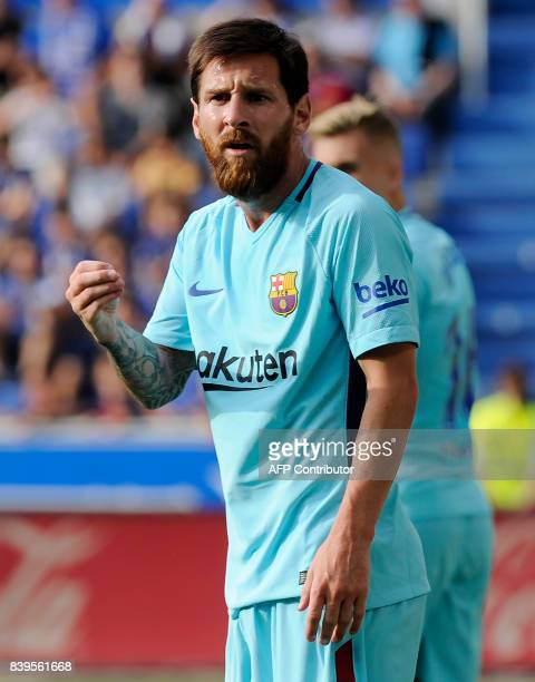 Barcelona's Argentinian forward Lionel Messi gestures during the Spanish league football match Deportivo Alaves vs FC Barcelona at the Mendizorroza...