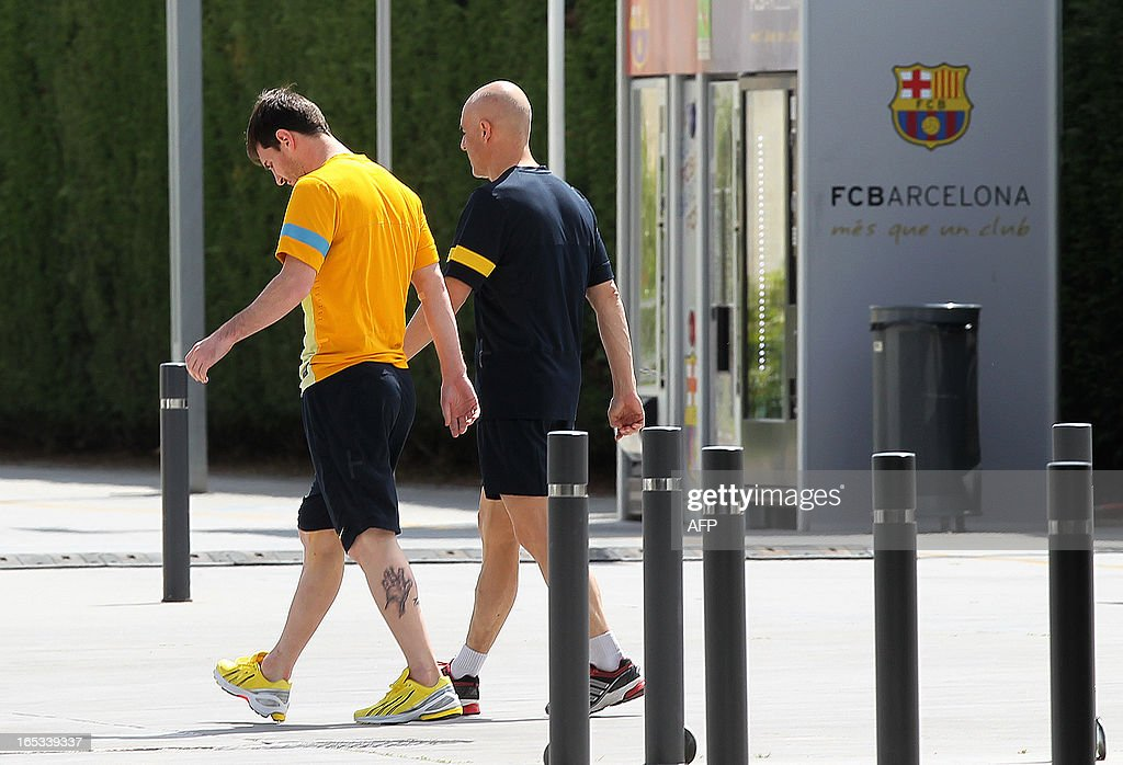 Barcelona's Argentinian forward Lionel Messi (L) goes to the medical center of the FC Barcelona Sports Center Joan Gamper in Sant Joan Despi, near Barcelona, on April 3, 2013, a day after the UEFA Champions League quarter-final football match PSG vs Barcelona. Lionel Messi has not been ruled out of Barcelona's Champions League quarter-final second-leg against Paris Saint-Germain on April 10 despite suffering a hamstring problem in the first-leg on April 3. The four-time world player of the year was substituted at half-time of the 2-2 draw against Paris Saint-Germain and will miss the Liga clash with Mallorca on April 6.