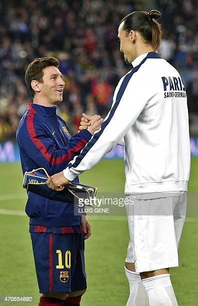 Barcelona's Argentinian forward Lionel Messi greets Paris Saint-Germain's Swedish forward Zlatan Ibrahimovic before the UEFA Champions League...
