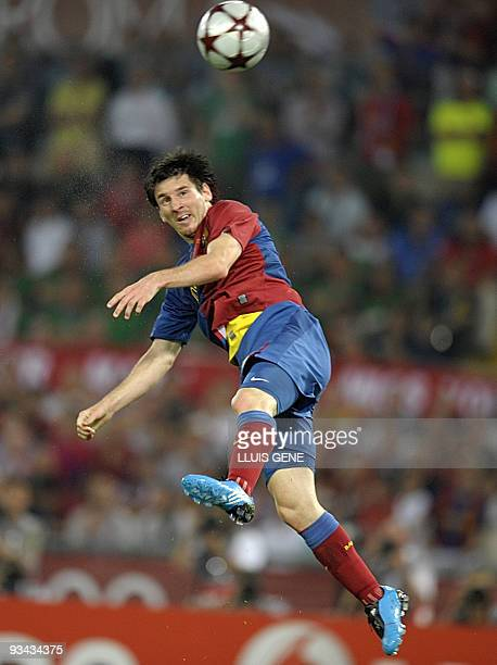 Barcelona´s Argentinian forward Lionel Messi heads the ball to score against Manchester United's Dutch goalkeeper Edwin van der Sar during the final...