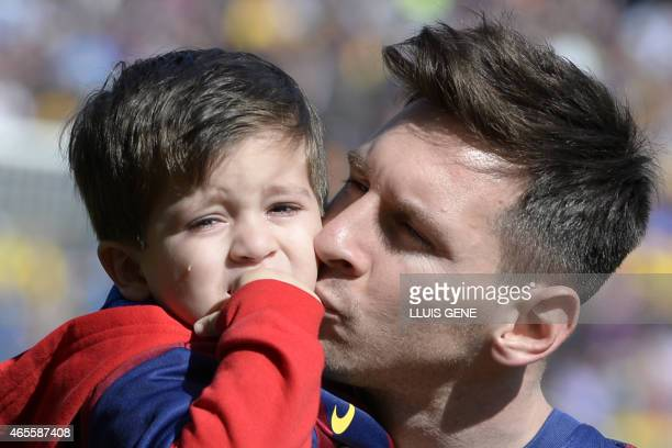 Barcelona's Argentinian forward Lionel Messi holds his son Thiago Messi before the Spanish league football match FC Barcelona vs Rayo Vallecano at...