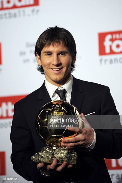 Barcelona's Argentinian forward Lionel Messi holds his trophy after receiving the European footballer of the year award the Ballon d'Or on December 6...