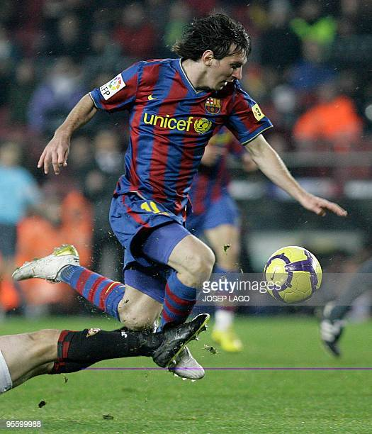 Barcelona's Argentinian forward Lionel Messi holds the ball during the Spanish Kings Cup match Barcelona vs Sevilla at the Camp Nou stadium in...