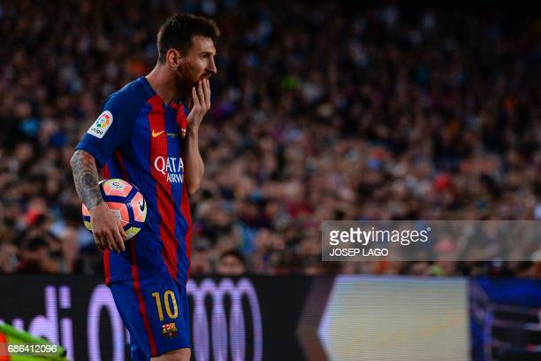 Barcelona's Argentinian forward Lionel Messi holds the ball on the sideline during the Spanish league football match FC Barcelona vs SD Eibar at the...