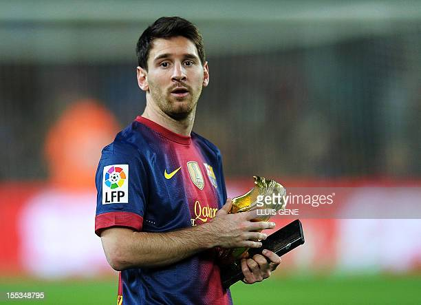 Barcelona's Argentinian forward Lionel Messi holds the European Golden Boot 2012 award for best European goalscorer of the 20112012 season before the...