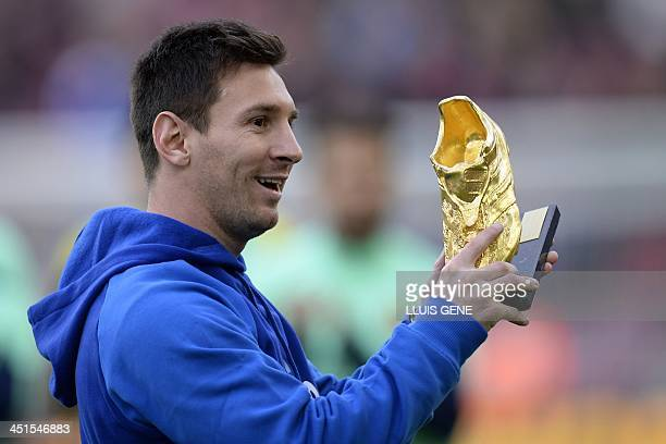 Barcelona's Argentinian forward Lionel Messi holds the Golden Shoe award before the Spanish league football match FC Barcelona vs CF Granada at the...