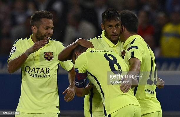 Barcelona's Argentinian forward Lionel Messi is congratulated by Barcelona's Brazilian forward Neymar after scoring a goal during the UEFA Champions...