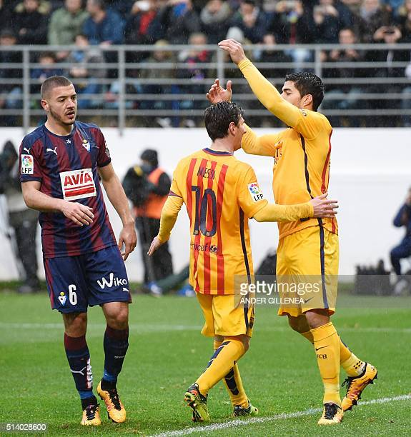 Barcelona's Argentinian forward Lionel Messi is congratulated by Uruguayan forward Luis Suarez after scoring during the Spanish league football match...