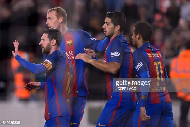 Barcelona's Argentinian forward Lionel Messi is congratulated by teammates Barcelona's French defender Jeremy Mathieu and Barcelona's Uruguayan...