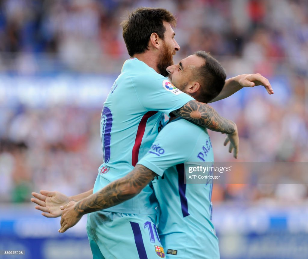 Barcelona's Argentinian forward Lionel Messi (L) is congratulated by teammate forward Paco Alcacer after scoring his team's second goal during the Spanish league football match Deportivo Alaves vs FC Barcelona at the Mendizorroza stadium in Vitoria on August 26, 2017. /