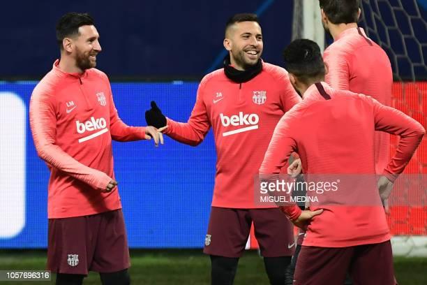 Barcelona's Argentinian forward Lionel Messi jokes with Barcelona's Spanish defender Jordi Alba during a training session on November 5 2018 at San...