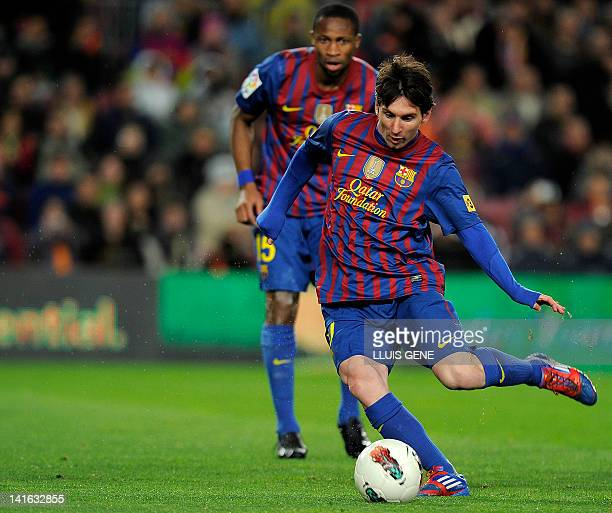 Barcelona's Argentinian forward Lionel Messi kicks a ball during the Spanish league football match FC Barcelona vs Granada on March 20, 2012 at the...
